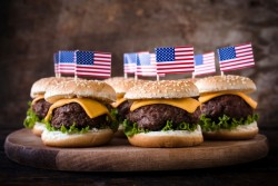 40846531 - mini beef burgers with american flag on wooden backgound,selective focus