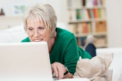Tech savvy senior woman on laptop