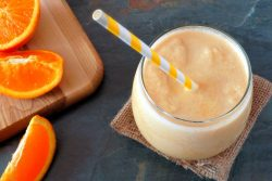 orange slices and smoothie with straw
