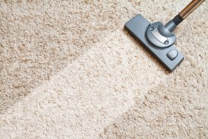 long beige carpet cleaning with a vacuum cleaner